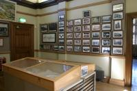 View of Waiting Vestibule (G7) looking north east showing the photographic display depicting the works between 1790 and 1929.
