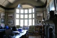 View of room (G5) the Chairmans Office looking east at the stone bay window with leaded glass panes.
