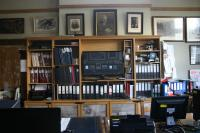 View of room (G5) the Chairmans Office looking north showing photographs, paintings, shelved archives and visual display equipment.